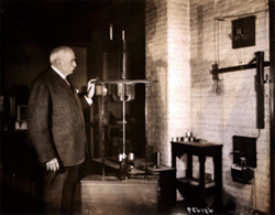 Charles F. Brush with his arc lamp