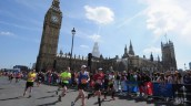 Competitors pass Westminster during the London Marathon in 2015